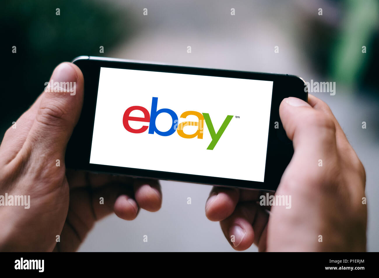 Closeup of iPhone Screen with eBay LOGO or ICON on smartphone Stock Photo