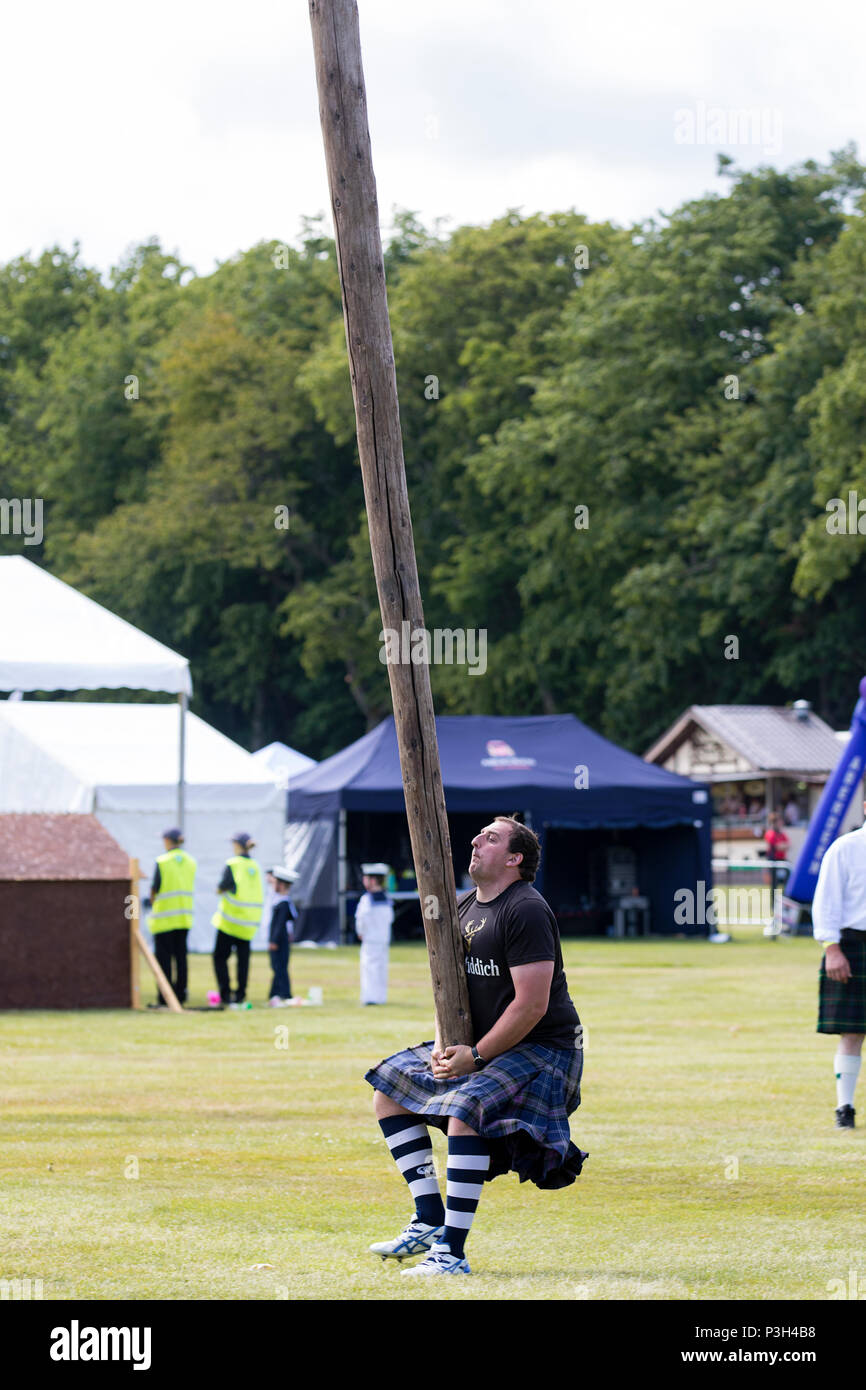 Aberdeen, Scotland - Jun 17, 2018: A competitor in the caber toss, a traditional Scottish Highland Games event, about to toss the caber. Credit: AC Images/Alamy Live News Stock Photo