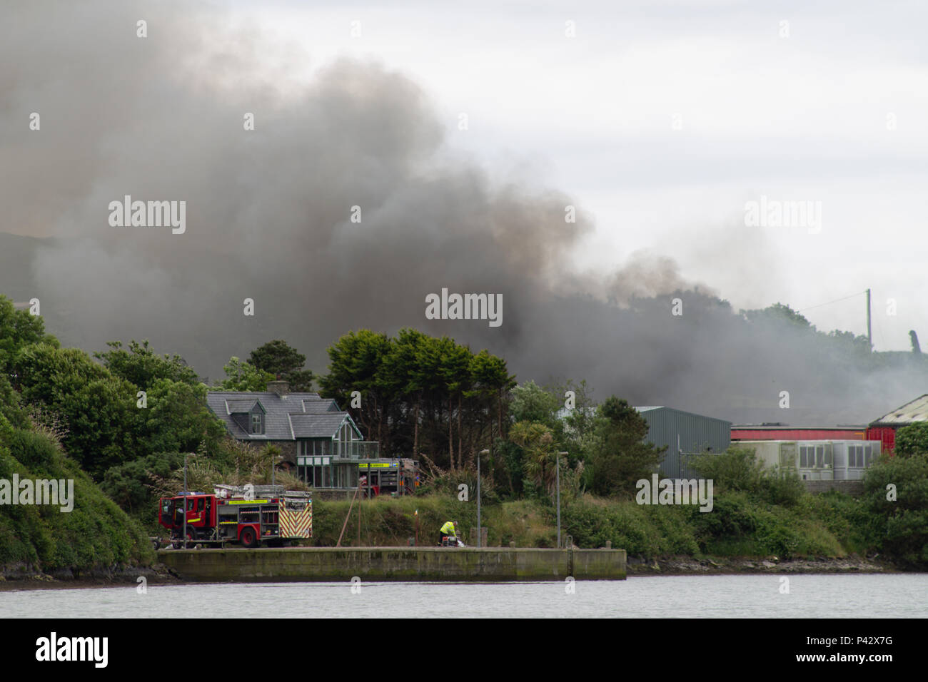 baltimore-ireland-20th-june-2018-a-large-fire-in-the-fish-factory-near-baltimore-today-caused-the-evacuation-of-the-local-school-huge-plumes-of-toxic-smoke-were-carried-towards-the-school-causing-the-evacuation-fire-appliances-from-all-over-the-local-area-attended-as-firemen-battled-to-control-the-blaze-local-roads-were-closed-with-diversions-in-place-but-no-casualties-were-reported-credit-aphperspectivealamy-live-news-P42X7G.jpg
