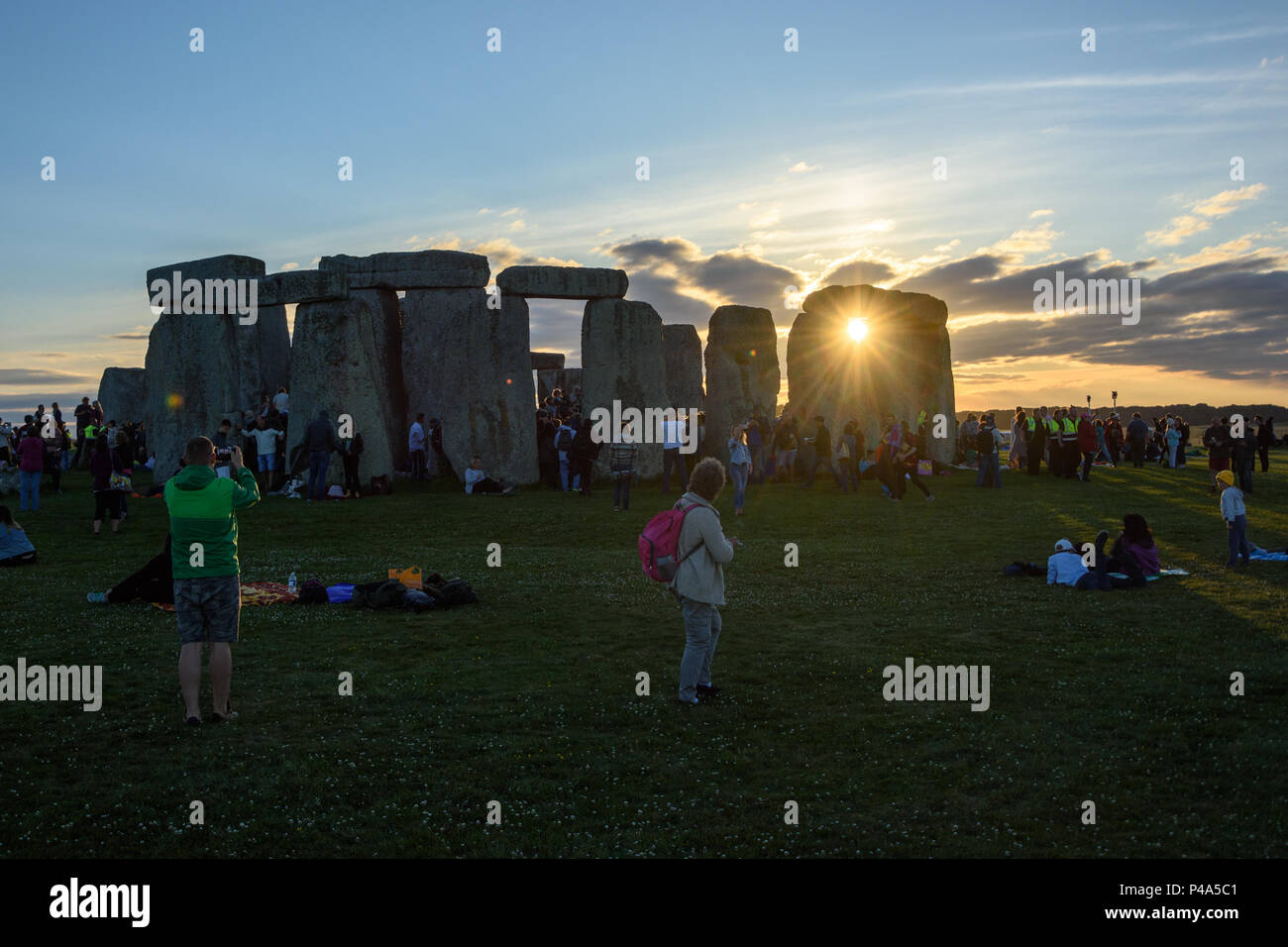 Stonehenge, Amesbury, UK, 20th June 2018,   Setting sun visible between 2 stones at stonehenge on summer solstice  Credit: Estelle Bowden/Alamy Live News.Stock Photo
