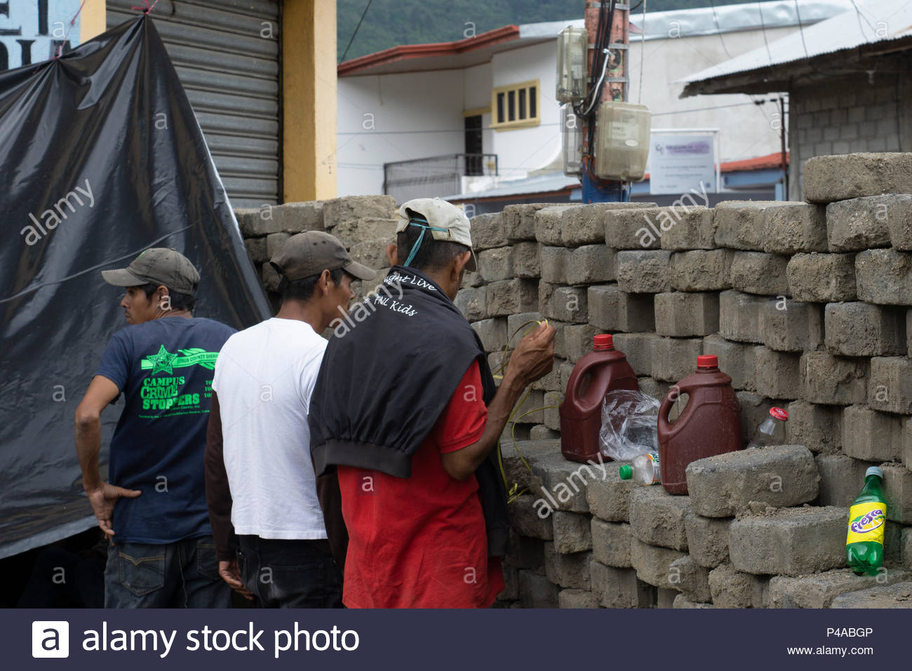 Jinotega, Nicaragua, 21st June, 2018, defenders behind the barricades.  This is a manned barricade and defenders have been sleeping under plastic sheets where the barricades are manned 24/7. Credit: Rebecca Brown/Alamy Live News Stock Photo