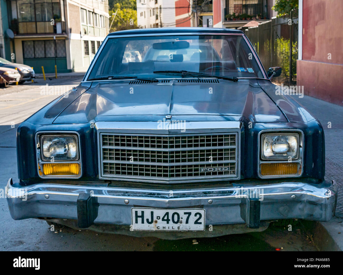 old-ford-car-parked-in-street-santiago-c