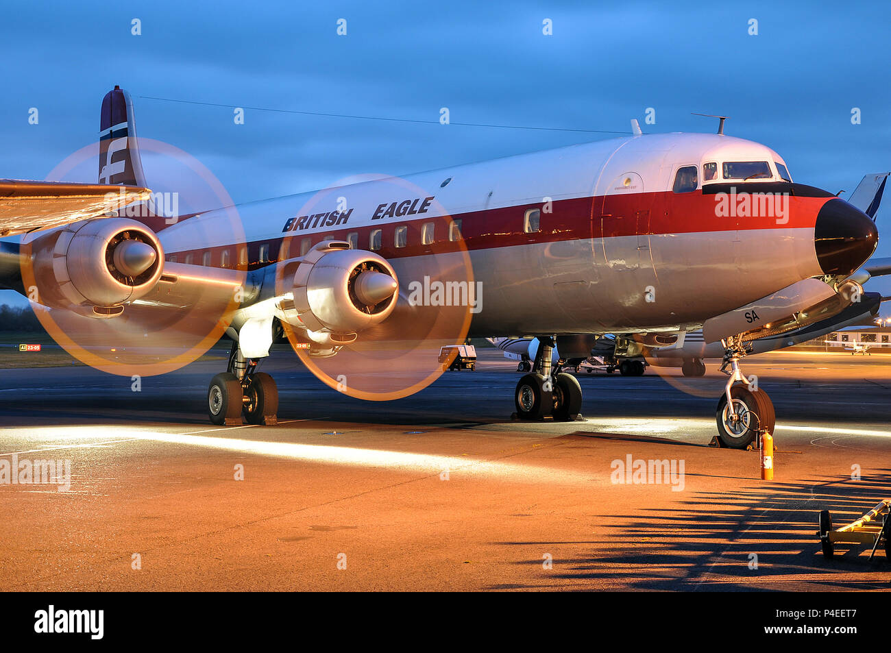 british-eagle-scheme-douglas-dc-6-vintage-airliner-plane-at-coventry-airport-uk-running-its-engines-at-dusk-g-apsa-space-for-copy-P4EET7.jpg