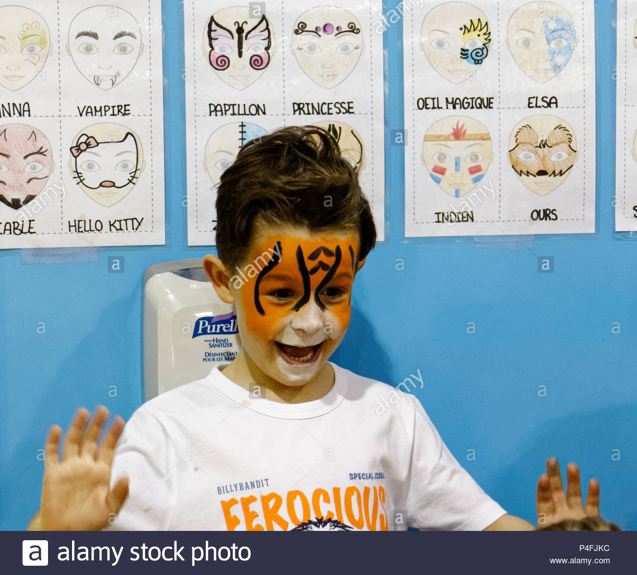 a-five-year-old-boy-looks-delighted-with-his-new-tiger-face-paint-P4FJKC.jpg