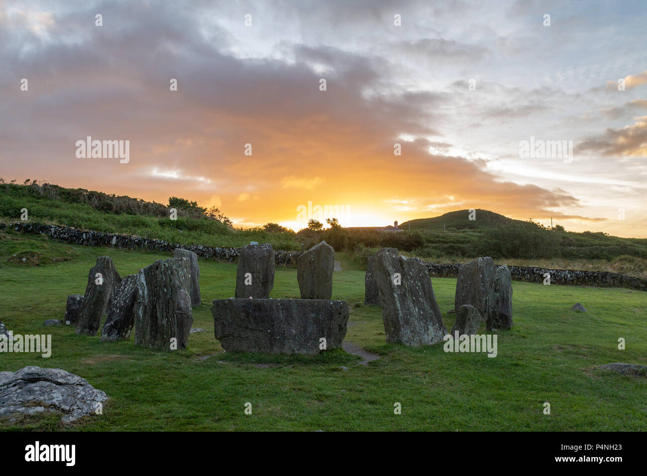 sunrise-over-drombeg-stone-circle-marking-the-summer-solstice-in-west-cork-ireland-P4NH23.jpg
