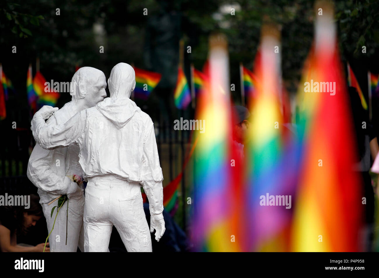 New York, New York, USA. 22nd June, 2018. Statues at Stonewall National Monument in New York City's Greenwich Village commemorate where the Pride movement was born, following a series of demonstrations in response to a police raid of the Stonewall Inn bar in 1969.  The monument is ringed with rainbow flags as Pride events get underway in New York City this weekend, including this Sunday's Pride march. Credit: Adam Stoltman/Alamy Live News Stock Photo