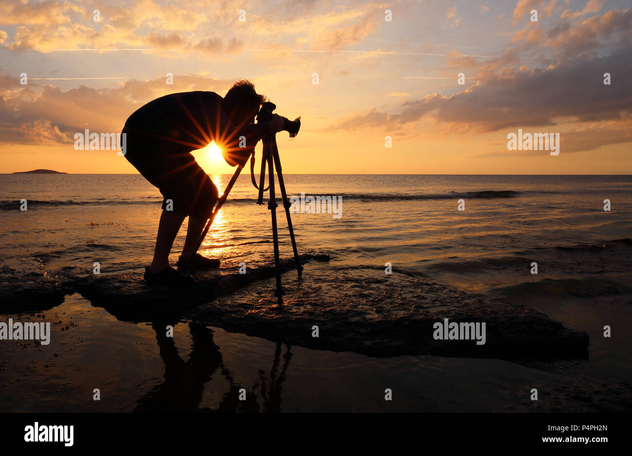 nature-photographer-working-at-sunset-to