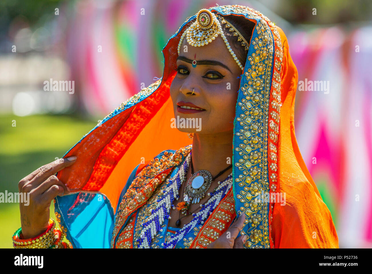 Glasgow, UK. 24th June, 2018. On a sunny summers day, thousands turned out to the annual Glasgow Mela held in Kelvingrove Park to enjoy a day of celebration of all aspects of Asian culture. There were many Asian bands and dance troops including the RAJASTAN HERITAGE BRASS BAND on their second appearance at the Mela and the GABHRU PANJAB DE Asian dance troop from Birmingham on their first appearance Credit: Findlay/Alamy Live News Stock Photo