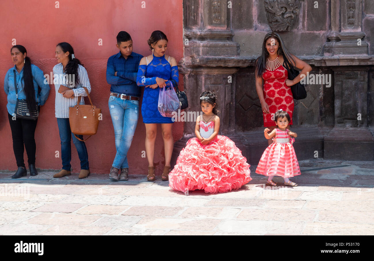 children-in-wedding-outfits-outside-a-ch