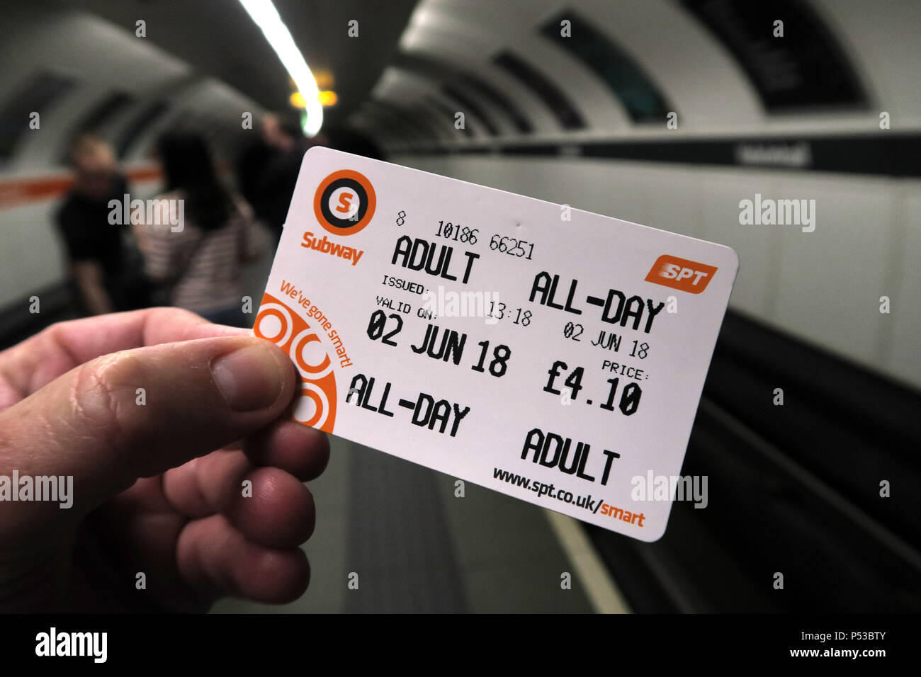 GoTonySmith,@HotpixUK,subway,railway,city centre,train,transport,passenger,passengers,orange,rolling stock,Metro Cammell,Glasgow District Subway,narrow guage,Outer Circle,Inner Circle,integrated,electric,branding,corporate identity,adult,allday,all-day,smartcard,system,ticket,card,inside,carriage,station,held,fingers,holding,holding a smartcard,economic,travel,SPT Smart