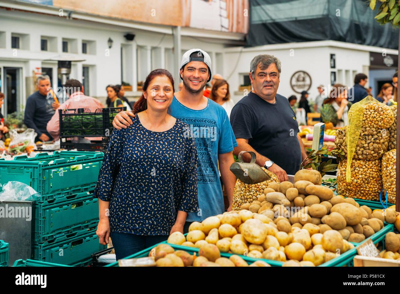 cascais-portugal-june-9th-2018-illustrative-editorial-of-friendly-family-of-market-vendors-at-cascaiss-food-market-P581CX.jpg