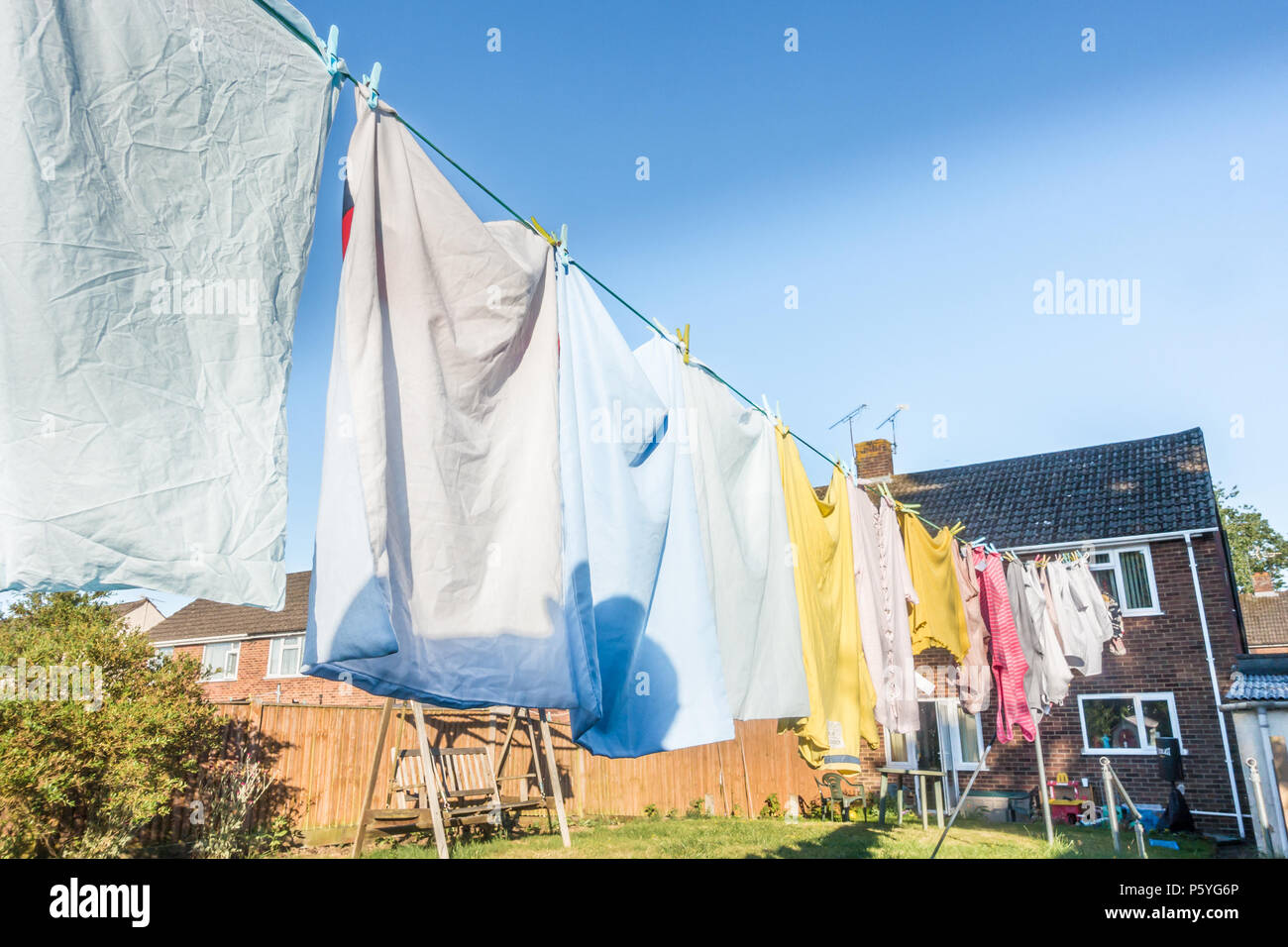 clothes-hanging-on-a-washing-line-in-a-residential-garden-to-dry-P5YG6P.jpg
