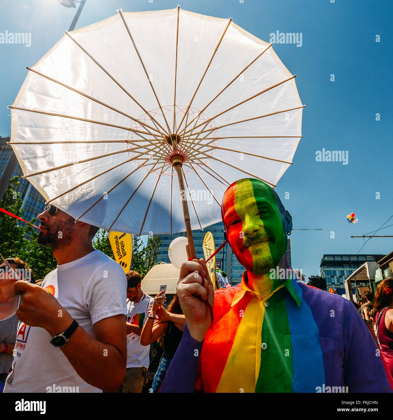 Milan, Italy - June 30, 2018: People at the annual Milan, Italy Pride Parade, where thousands march celebrating and claiming equality and legal rights for lesbian, gay, bisexual, and transgender (LGBT) people and their allies. Milano Pride is one of the largest LGBT organised events in Italy Credit: Alexandre Rotenberg/Alamy Live News Stock Photo