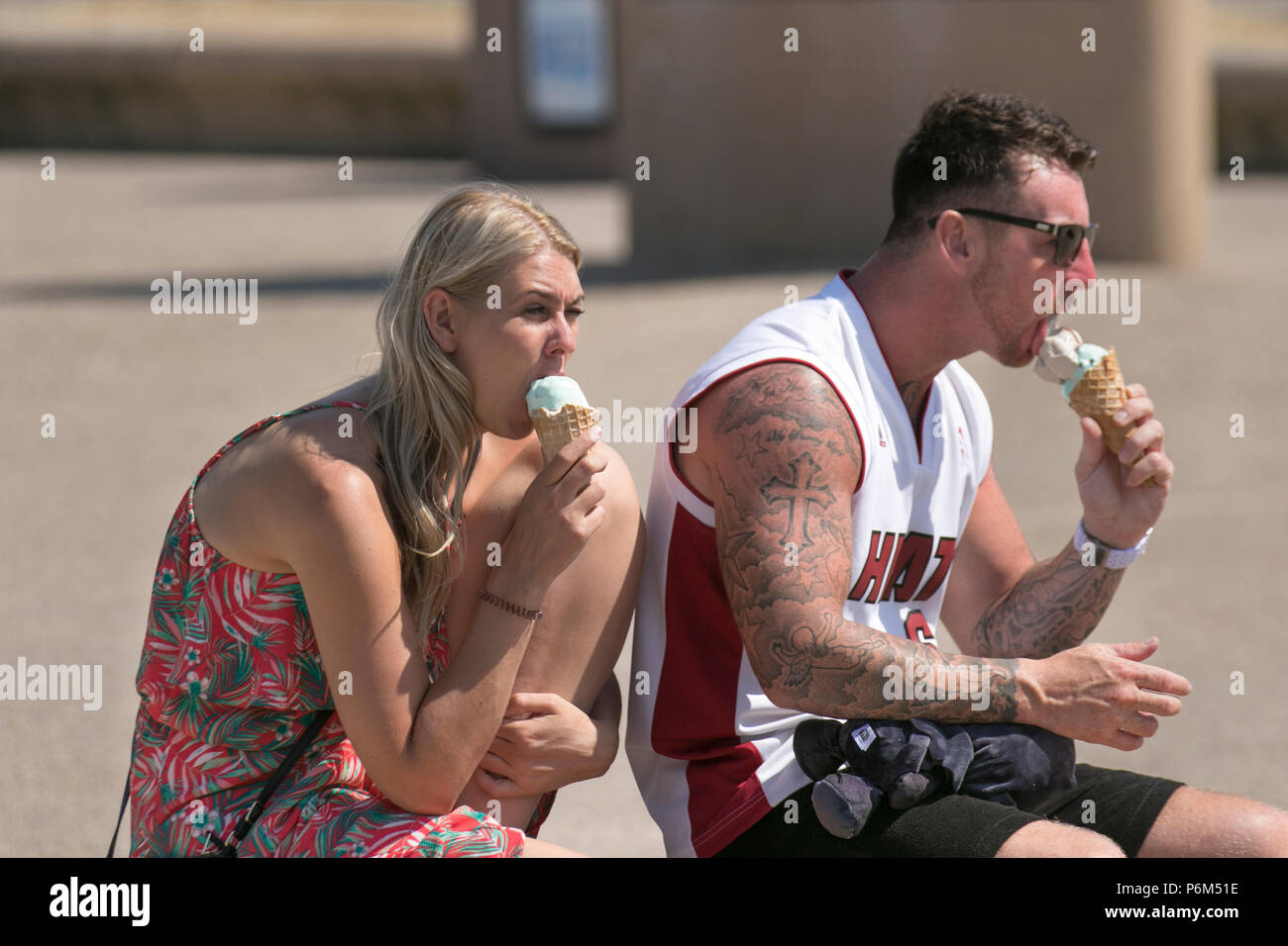 Blackpool, Lancashire, 1st Jul, 2018. UK Weather: Sunny sweltering day at the coast as sun worshippers enjoy spell on the beach before being chased by the incoming tide. Credit: MediaWorldImages/AlamyLiveNews Stock Photo