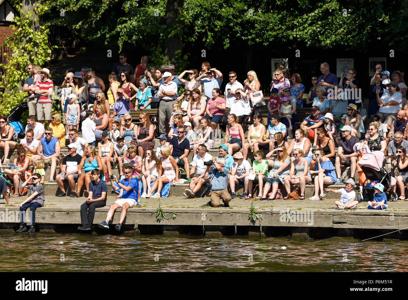 Chester, UK. 1st July 2018. Crowds enjoy the sunshine at The Groves alongside the River Dee while watching the annual charity raft race. Credit: Andrew Paterson / Alamy Live News Stock Photo