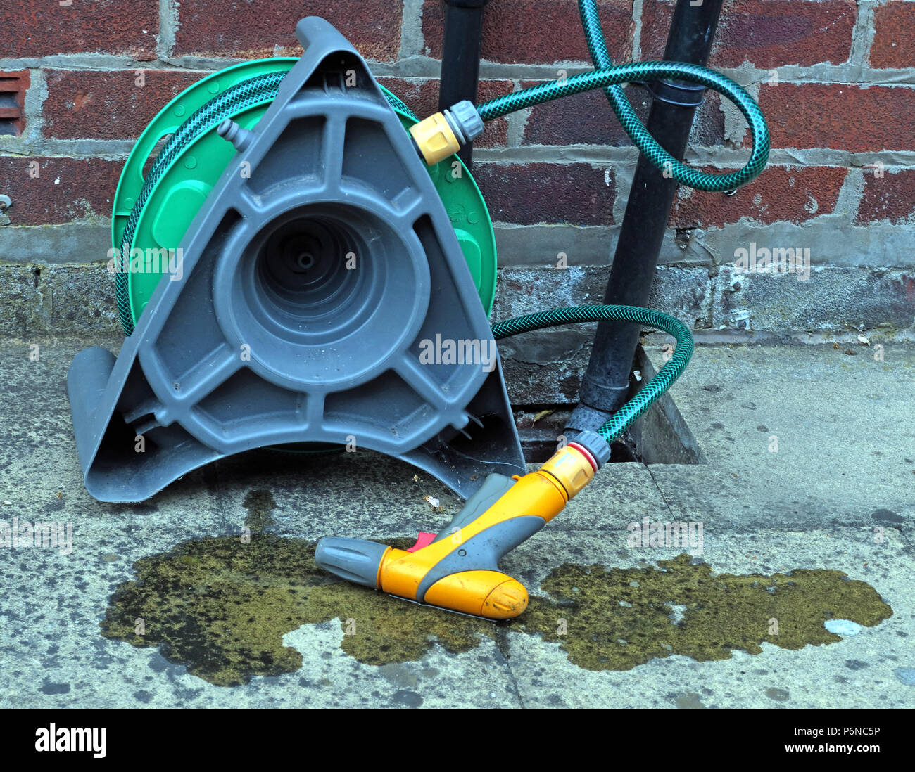 @Hotpixuk,GoTonySmith,hose pipe,hose,pipe,system,Hosepipe,reel,connected,to a,in,garden,with,leak,water,leaking,heat wave,drought,shortage,water shortage,chances,hot,weather,hot weather,trigger,waste,wasting water,bone,dry,dry environment,United Kingdom,British,Great Britain,Met Office,summer,Environment Agency,Restrictions,on water usage,water use,water shortage issue