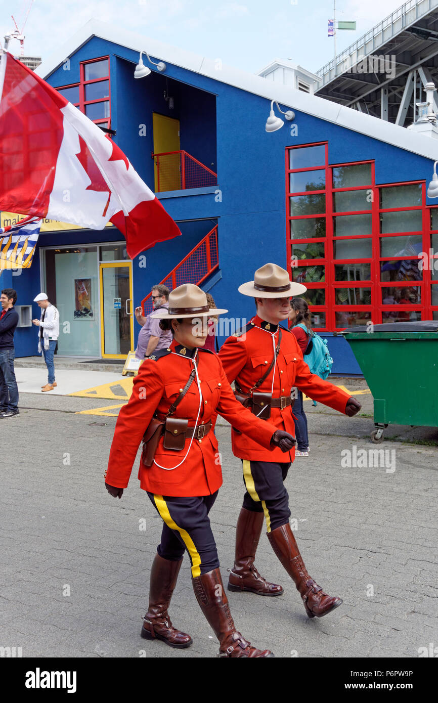 two-rcmp-officers-march-in-the-annual-ca