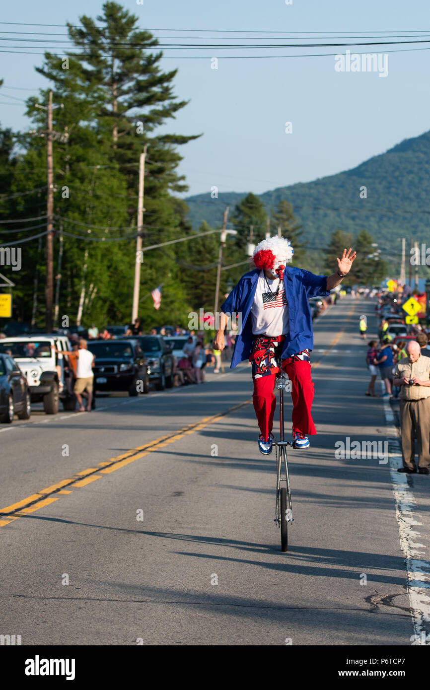 a-happy-clown-dressed-up-in-red-white-and-blue-riding-a-unicycle-in-the-4th-of-july-parade-held-on-june-30-2018-in-speculator-ny-usa-P6TCP7.jpg