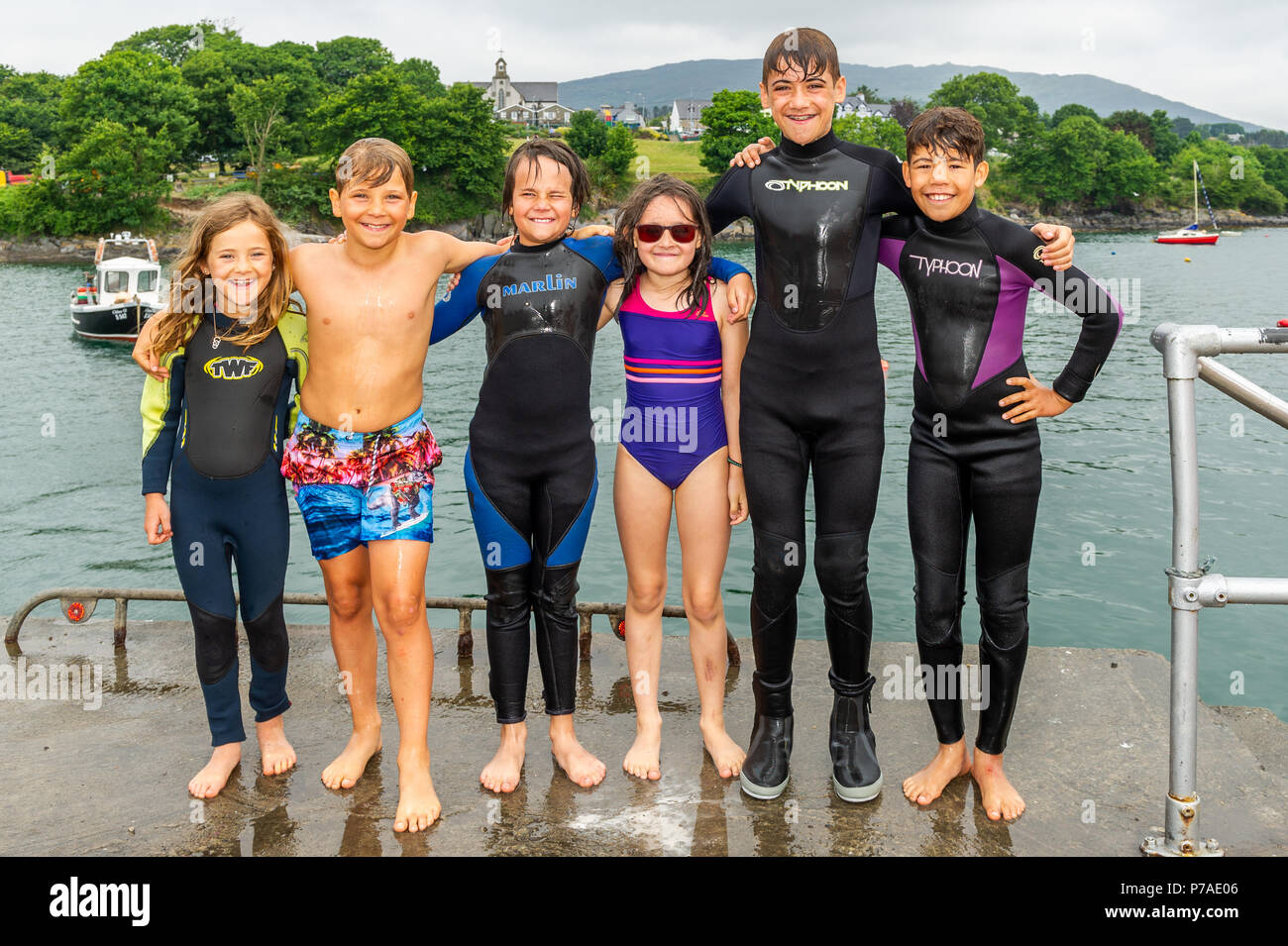 schull-west-cork-ireland-a-group-of-children-take-the-chance-to-jump-off-schull-pier-into-the-water-l-r-aoibhinn-and-oran-reilly-cork-oliver-and-ati-toro-colombia-conall-reilly-cork-and-alex-odonnell-cork-after-a-cool-and-overcast-start-to-the-day-temperatures-are-beginning-to-rise-with-highs-of-around-30-celsius-expected-over-the-weekend-and-into-next-week-credit-andy-gibsonalamy-live-news-P7AE06.jpg
