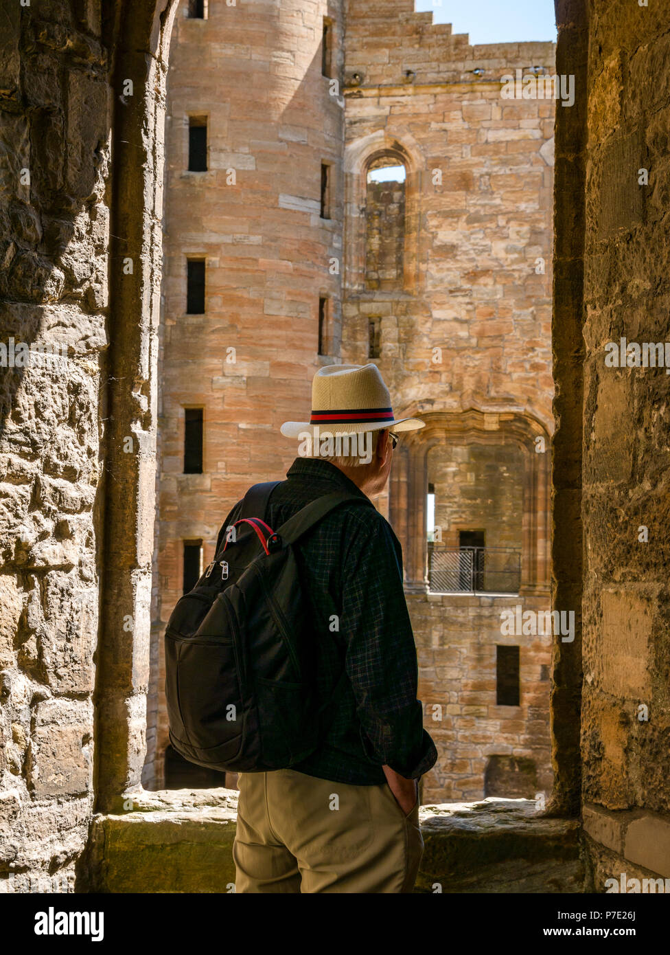 man-with-backpack-wearing-panama-hat-sta