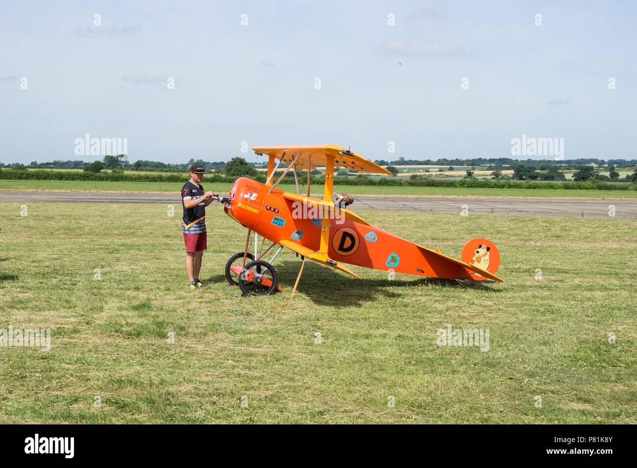 large-model-of-fokker-dri-triplane-with-builder-at-wings-and-wheels-P81K8Y.jpg