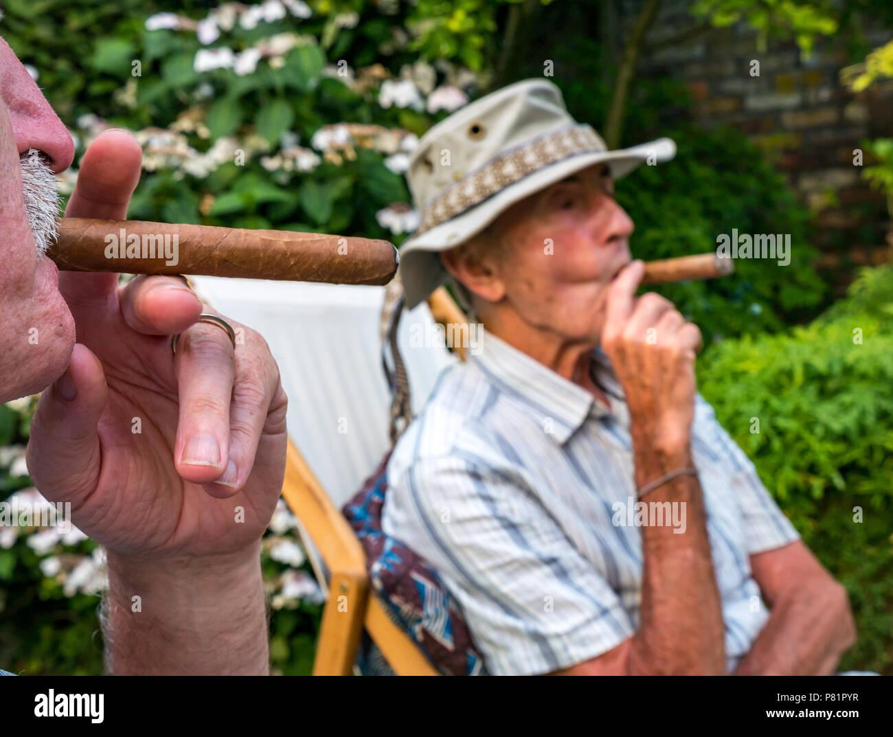 close-up-of-two-senior-men-sitting-in-de