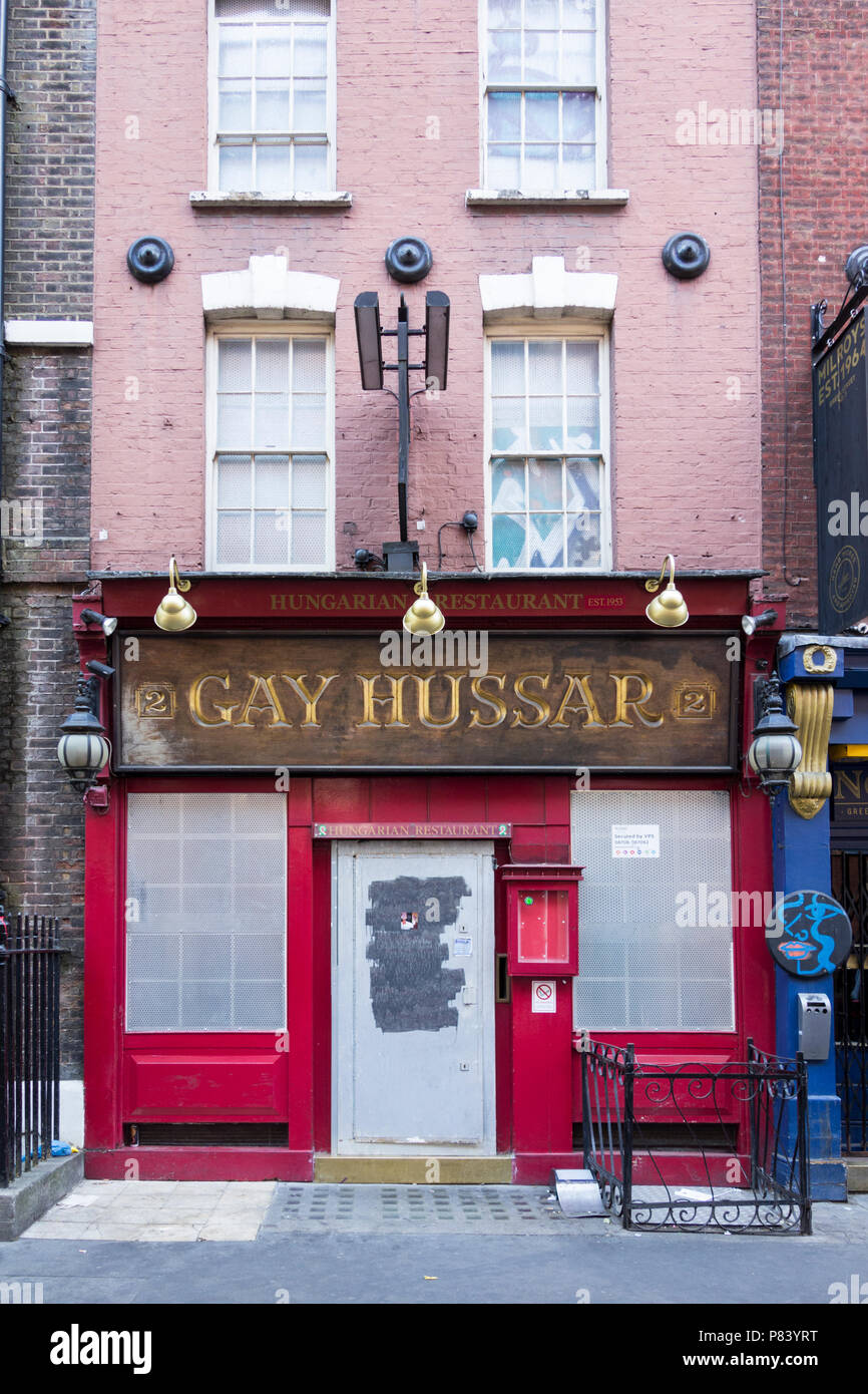 Last orders for the now-closed Soho dining landmark, the Gay Hussar restaurant on Greek Street, Soho, London, UK Stock Photo