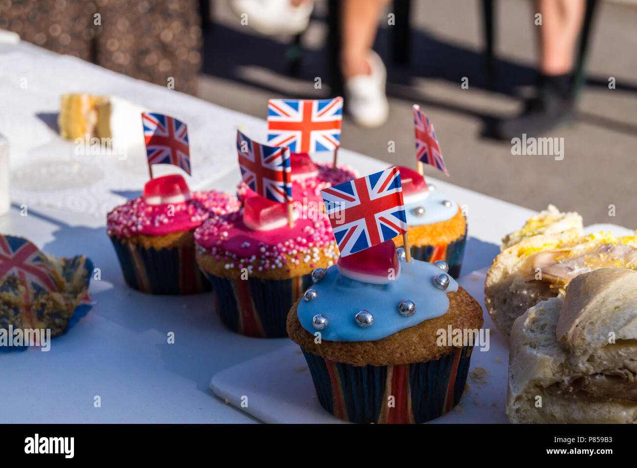 fairly-cakes-with-union-flags-street-party-wedding-of-prince-harry-and-meghan-markle-may-19th-2018-fullers-road-london-e18-england-P859B3.jpg