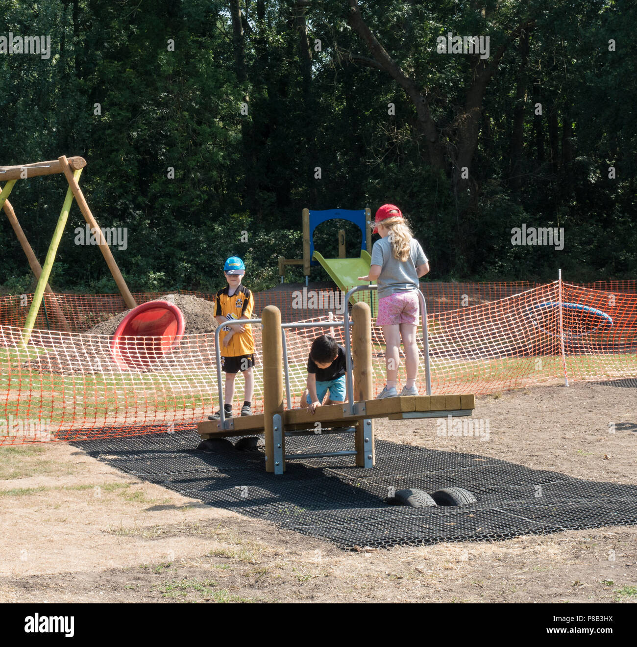children-on-seesaw-P8B3HX.jpg