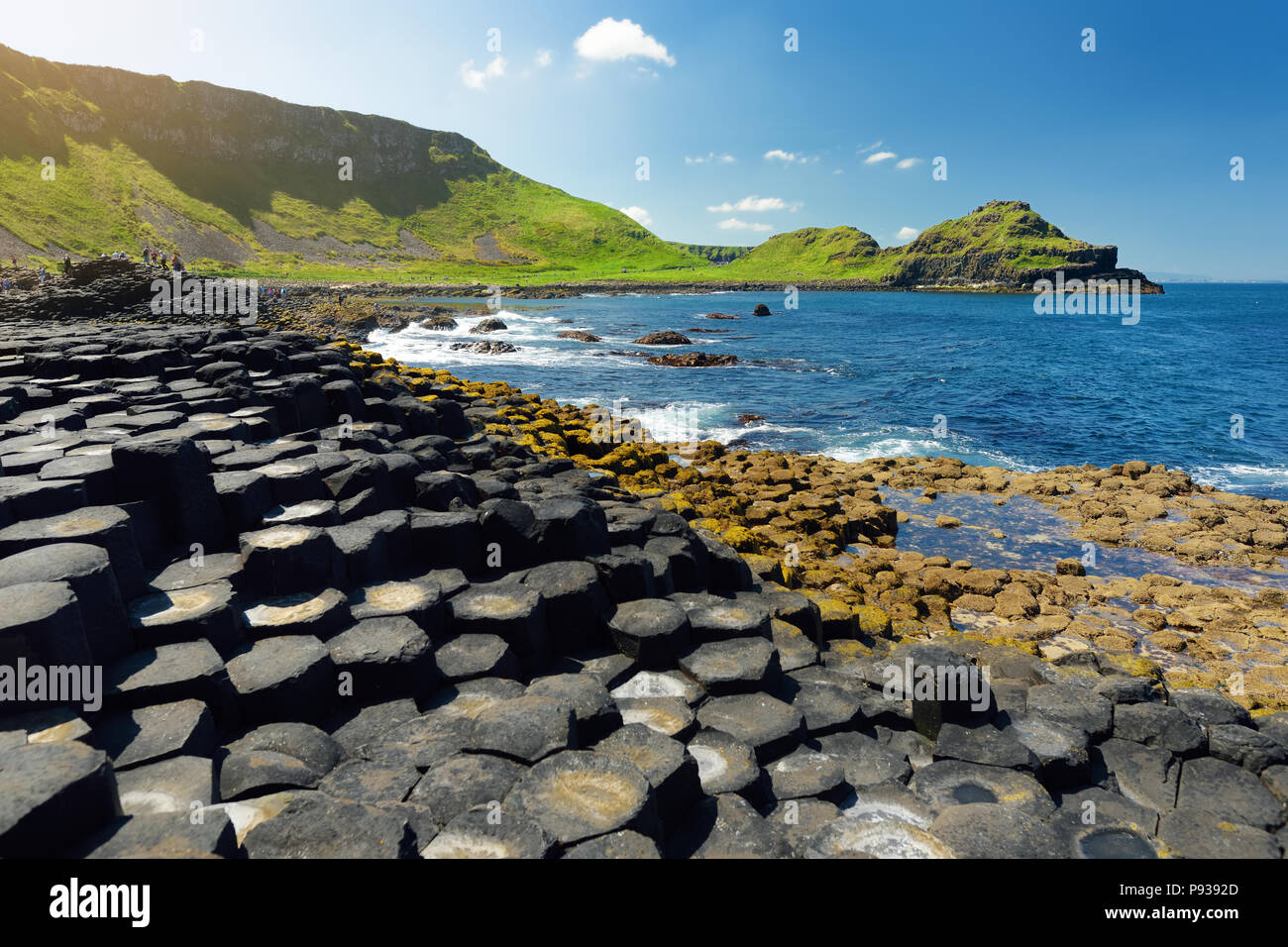 Giants Causeway, an area of hexagonal basalt stones, created by ancient volcanic fissure eruption, County Antrim, Northern Ireland. Famous tourist attStock Photo