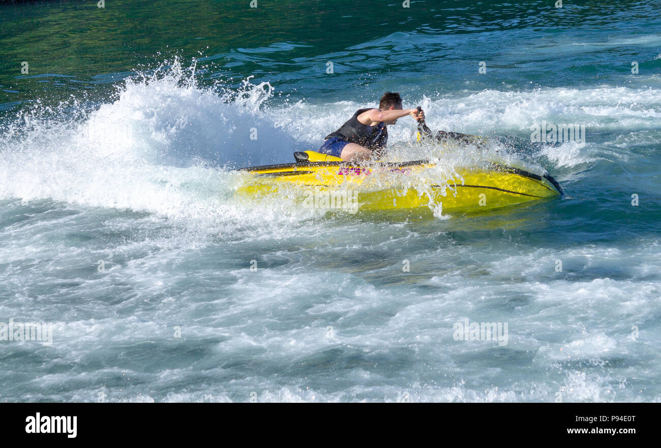 young-man-having-fun-on-a-jet-ski-P94E0T.jpg