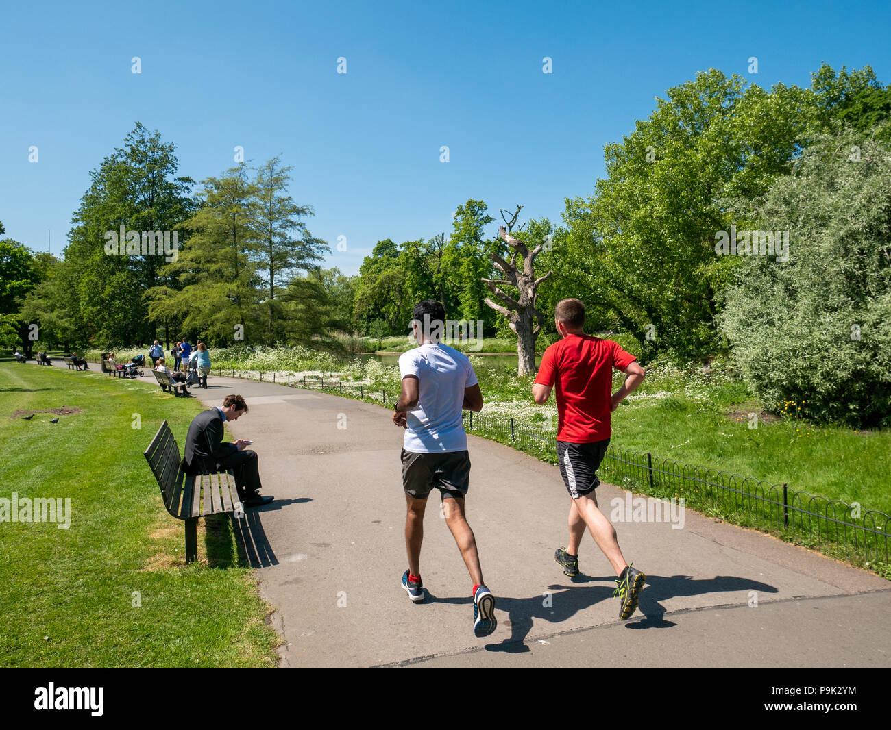 Joggers running at Regent's Park, London, UK Stock Photo