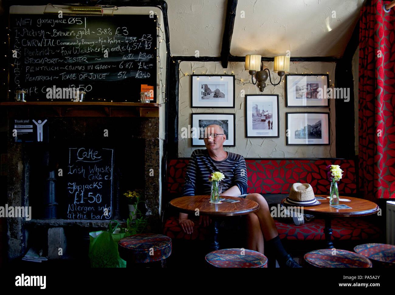 Middle-aged man in the Fox & Goose pub, Hebden Bridge, Calderdale, West Yorkshire, England UK Stock Photo