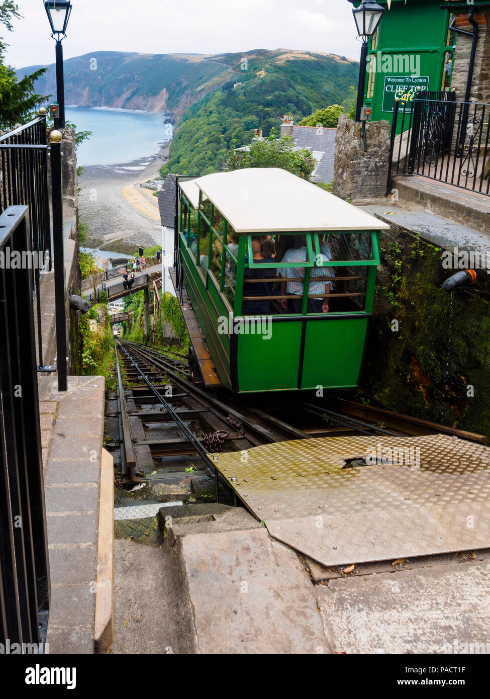 carriage-descending-on-the-1888-lynton-to-lynmouth-cliff-railway-lynmouth-bay-devon-uk-in-the-background-PACT1F.jpg