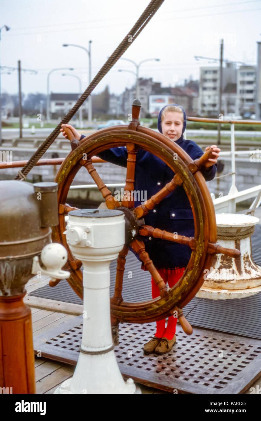 young-girl-steering-ship-wheel-on-histor