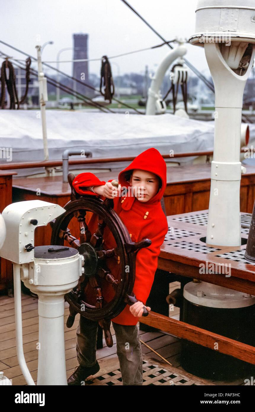 young-boy-wearing-red-duffel-coat-steeri