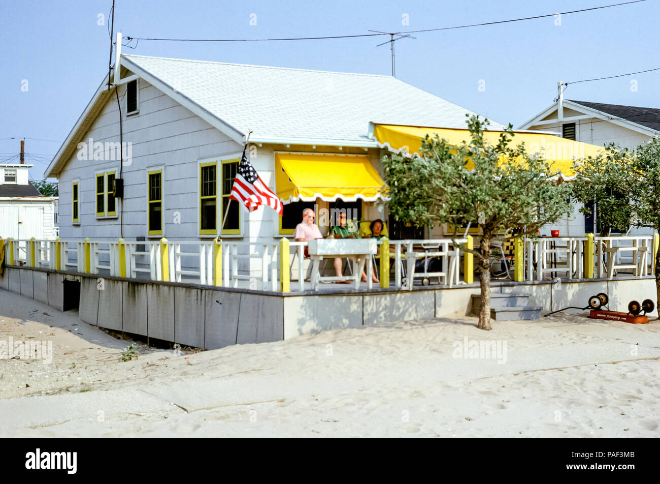 people-relaxing-on-a-bungalow-porch-at-b