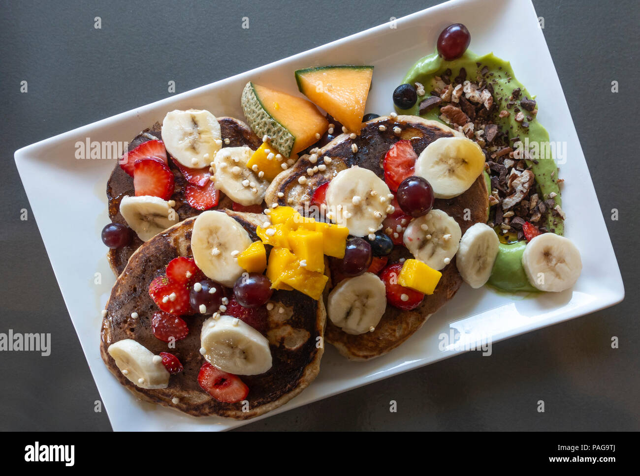 pancakes-with-mixed-fresh-fruit-PAG9TJ.j