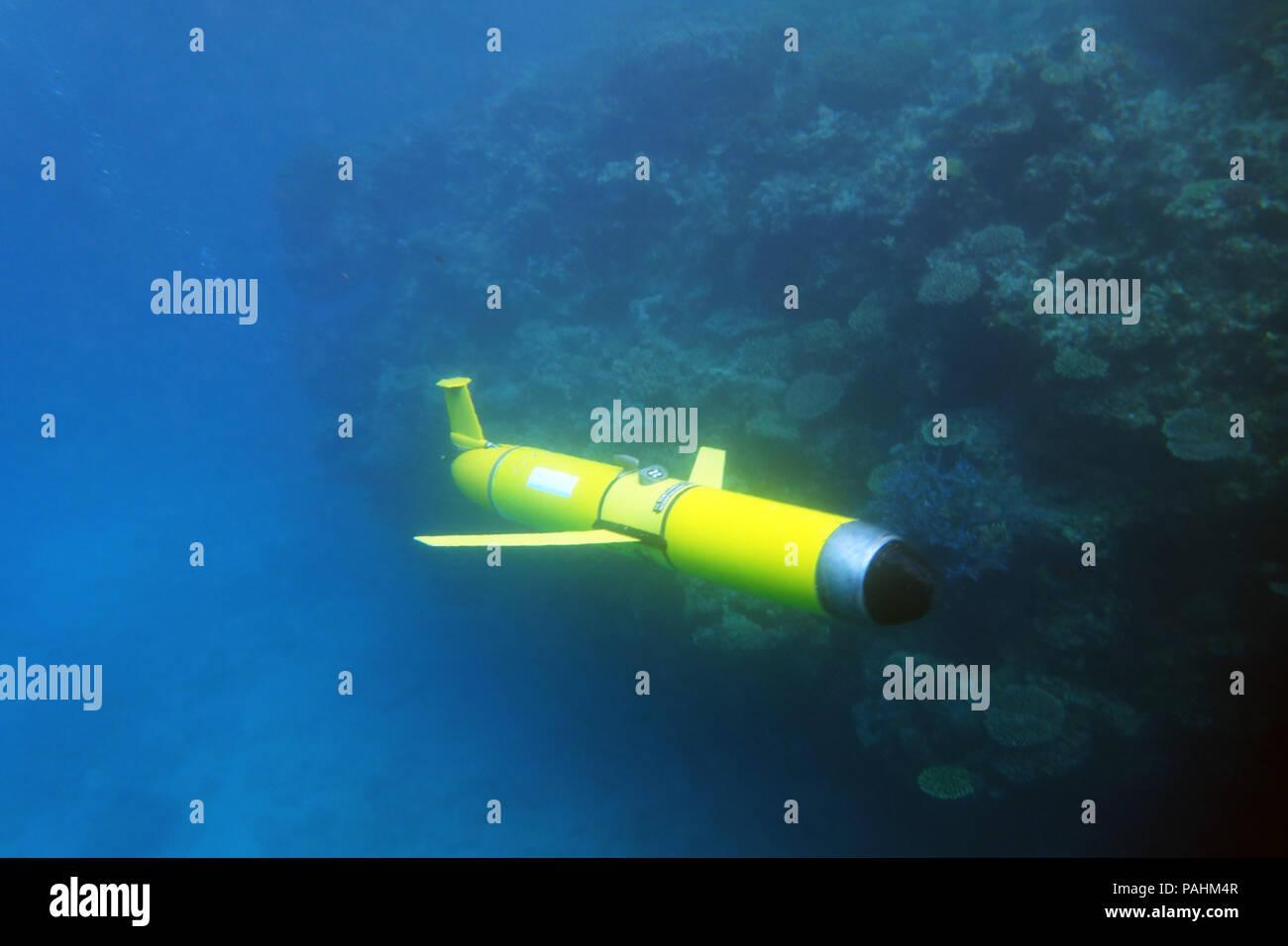 Slocum ocean glider (autonomous underwater oceanographic instrument) passing reef redge, Great Barrier Reef, Queensland, Australia. No PR Stock Photo