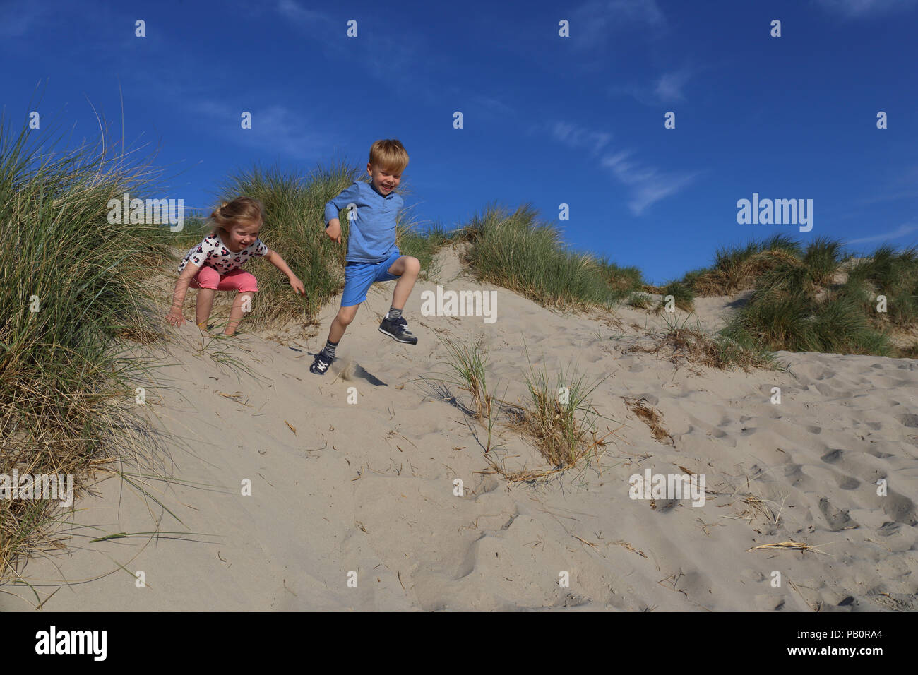 two-children-enjoying-themselves-on-the-