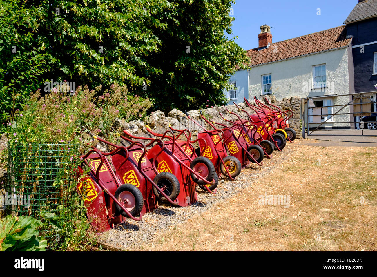 Thornbury, a south gloucestershire town england uk. The wheelbarrows at the allotments , painted in the colours of the LMS Railway. Stock Photo