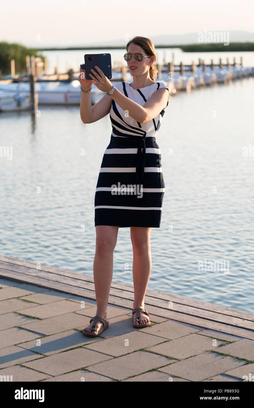 a-tourist-in-a-chic-navy-and-white-dress