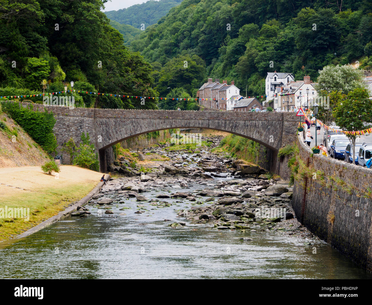a39-road-bridge-arches-over-the-boulder-strewn-east-lyn-river-at-lynmouth-devon-uk-PBHDNP.jpg