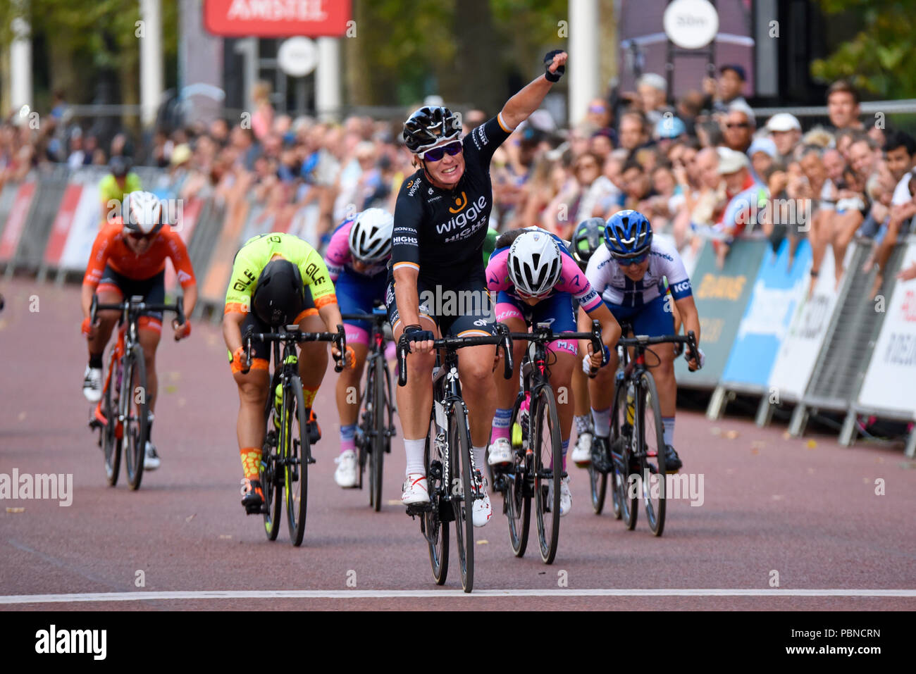kirsten-wild-of-wiggle-high5-crossing-the-line-and-celebrating-winning-after-racing-in-the-prudential-ridelondon-classique-womens-cycle-race-PBNCRN.jpg