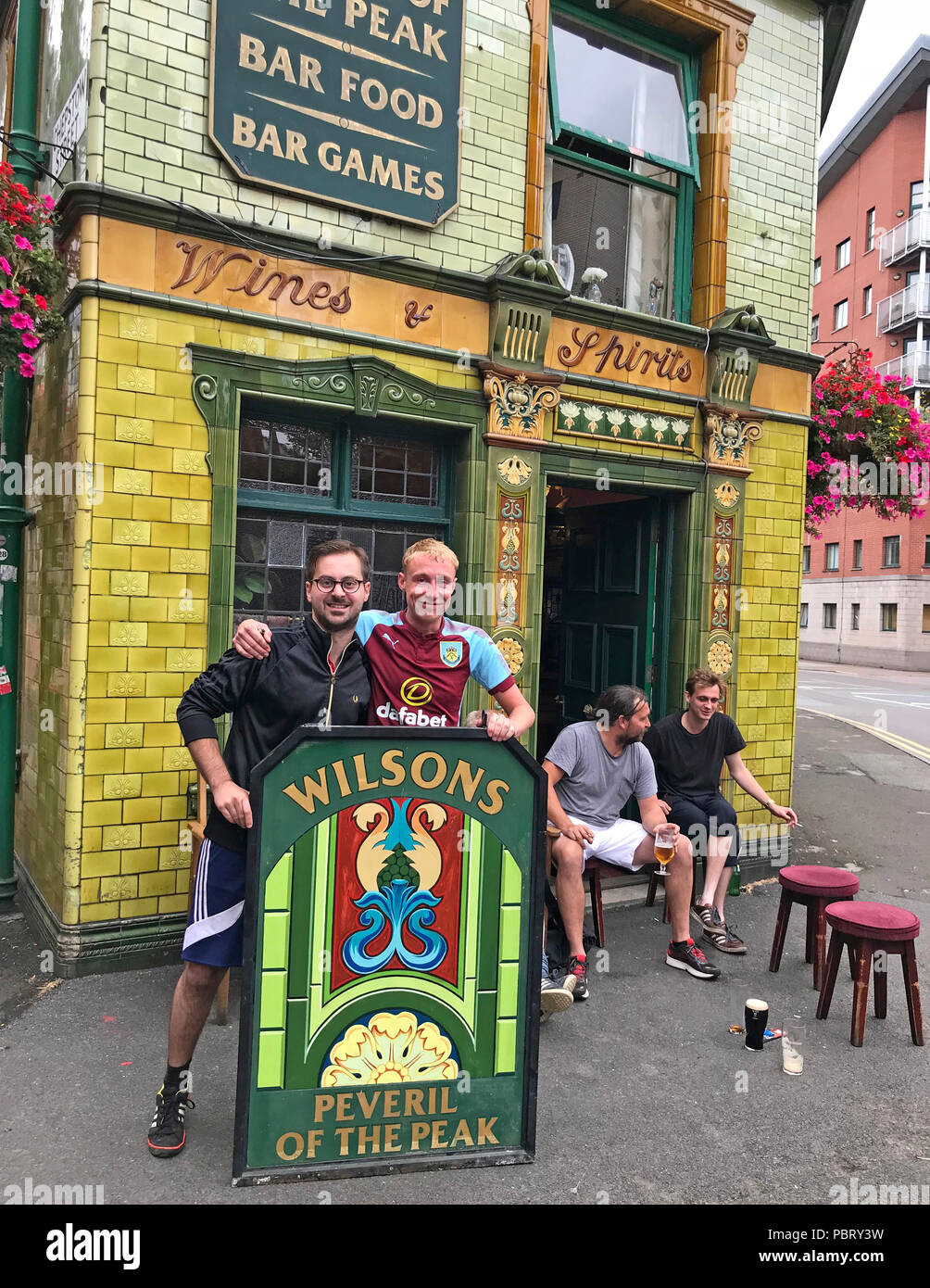 GoTonySmith,@HotpixUK,M1,pub,CAMRA,arrives,at,sign,painting,painted,Great Bridgewater Street,UK,M1 5JQ,green,tiles,tiled,green tiled pub,tourist attraction,Manchester England,Sir Walter Scott,stagecoach,stage coach,mailcoach,mail coach,Luton,Peak District,Wines,Spirits,Wines & Spirits,Wines and Spirits,summer,bar food,pub games,Wilsons,brewery,outside,exterior,artist,painter