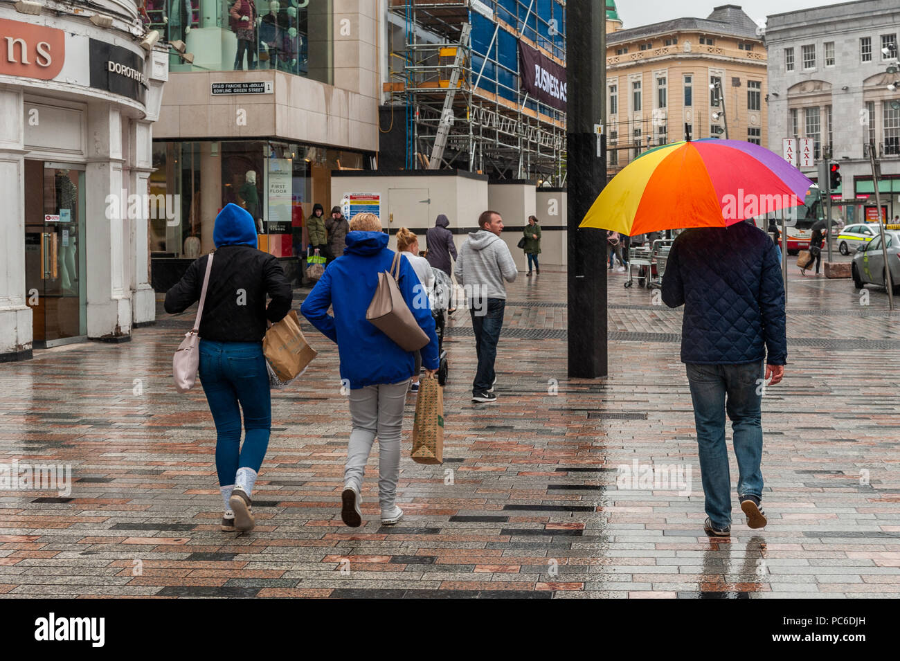 cork-ireland-1st-aug-2018-shoppers-in-patrick-street-cork-city-rush-to-get-out-of-the-rain-during-one-of-the-wettest-days-of-the-last-few-weeks-the-rain-will-give-way-to-hot-sunny-weather-this-weekend-with-temperatures-expected-to-hit-28-celsius-credit-andy-gibsonalamy-live-news-PC6DJH.jpg