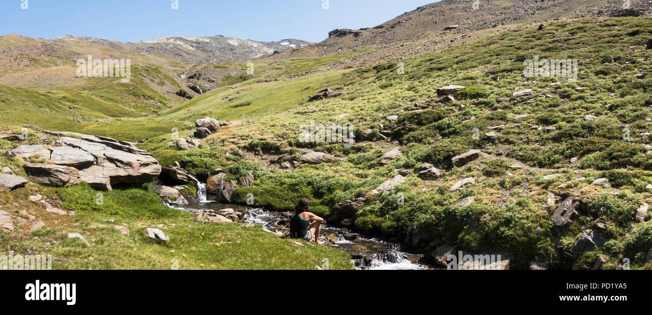 woman-next-to-river-stream-with-pico-de-