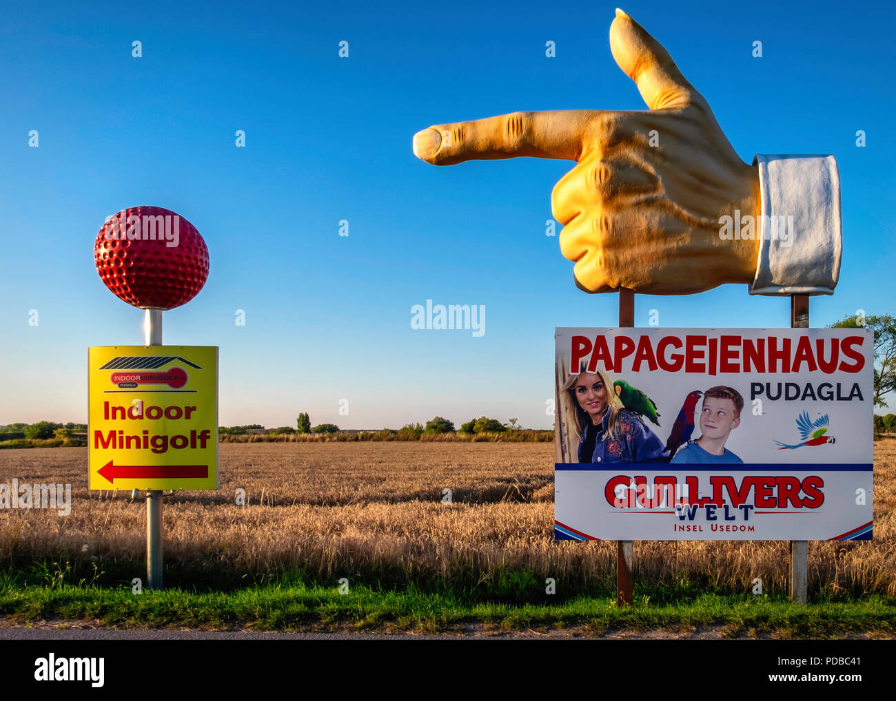 Signs advertise amusement parks  & family fun at Pudagla Business park,Mecklenburg-Vorpommern,Germany Stock Photo