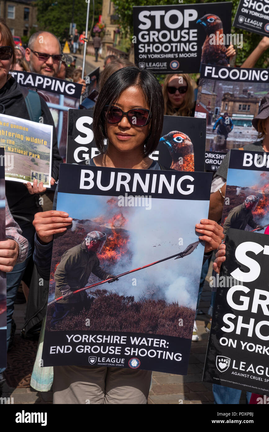 hebden-bridge-uk-11th-august-2018-rally-to-ban-grouse-shooting-held-in-hebden-bridges-st-georges-square-the-nearby-uplands-are-let-out-by-yorkshire-water-to-grouse-shooters-who-are-accused-of-decimating-the-wildlife-for-sport-by-trap-and-gun-burning-large-sections-of-heather-to-increase-game-bird-numbers-and-decimating-blanket-bog-and-contributing-to-flooding-in-the-valley-the-protesters-urged-yorkshire-water-to-stop-leasing-land-above-the-town-for-grouse-shooting-credit-stephen-bellalamy-live-news-PDXPBJ.jpg