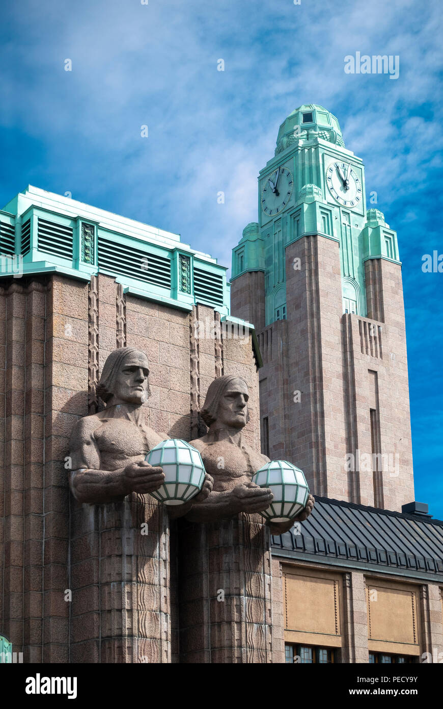 https://c7.alamy.com/comp/PECY9Y/central-railway-station-helsinki-with-two-stone-men-statues-holding-lamps-and-the-station-clock-tower-PECY9Y.jpg